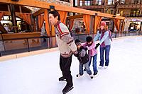 A family ice skating at Northstar ski resort near Lake Tahoe in California