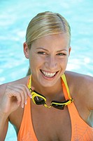 woman, young, blond, swimming_glasses, smiling, portrait,