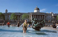 Trafalgar square and Nelson's column  Metro : Charring Cross  English woman standing inside a pool , London, Great Britain, Europe