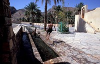 Waterway near the town, children playing, Nizwa, Oman, Middle East
