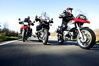 Country road, motorcyclists, three, front_view, streets, people, group, men, motorcycles, drives, exit, spin, hobby, leisure time, Lifestyle, motorcyc...