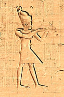 Pharaoh on the wall of Horus temple in Edfu, Egypt