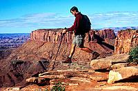 A man hiking in Cayonlands National Park, Utah, USA
