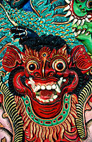 Barong mask carved on wooden chair. Bali. Indonesia