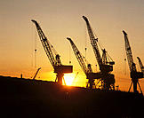 Cranes of ship building yard at sunset. River Clyde, Glasgow. Scotland