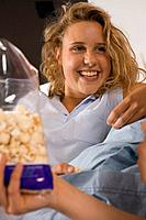 Two girls eating popcorn (thumbnail)