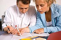 Teenage boy and girl doing homework