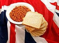 Plate of baked beans and white bread