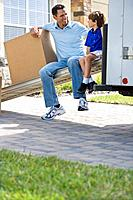 Father and Son Resting While Moving