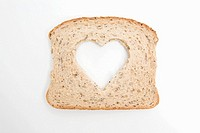 A slice of bread with a heart shape on it