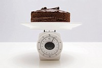 Chocolate cake on scales