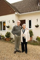 Senior couple outside house (thumbnail)