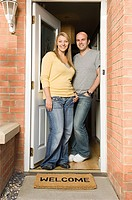 Couple standing in doorway
