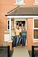 Family at front door of house