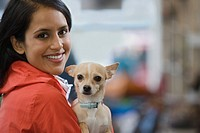 Woman with her pet chihuahua