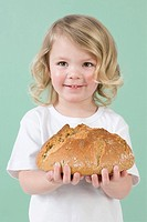 Girl holding bread