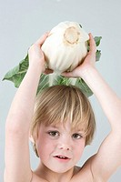 Boy holding chinese cabbage