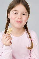 Girl eating cereal bar