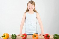 Girl with peppers in a row