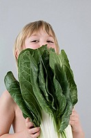 Boy with chinese cabbage