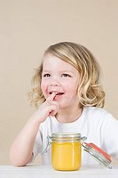 Girl with jar of lemon curd