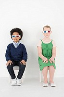 Boy and girl in 3D glasses