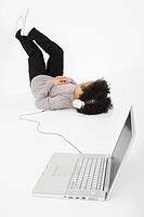 Boy listening to music on laptop