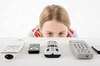 Girl looking at remote controls