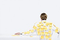 A man covered in adhesive notes