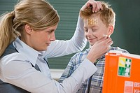 Teacher and boy with plaster on head
