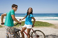 A teenage couple with bikes