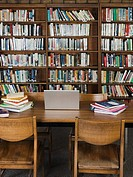 Laptop and books in library (thumbnail)