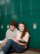 Boy and girl by lockers