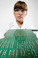 Scientist with circuit board (thumbnail)