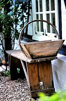 Old wooden bench and wooden basket