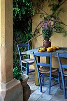 Mediterranean seat with blue chairs