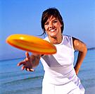 Woman in sportswear playing with frisbee