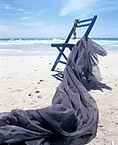 Chair and blue cloth on the beach