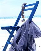 On the beach: blue folding chair