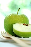 Apple and a wooden fork (thumbnail)
