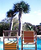 Chairs next to the swimming pool