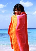 Child at the sea with a towel