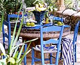 Rustic_style table with blue chairs