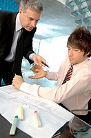 Businessman in discussion with colleague in office