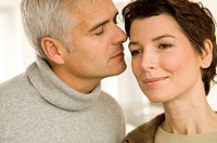 Close_up of a mature man and a mid adult woman romancing