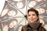 Close_up of a mid adult woman holding an umbrella