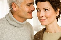 Close-up of a mature man and a mid adult woman romancing (thumbnail)