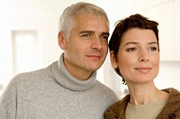Close_up of a mature man and a mid adult woman looking away