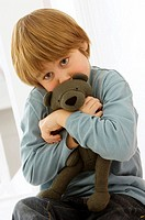 Boy holding a teddy bear