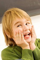 Close_up of a boy laughing